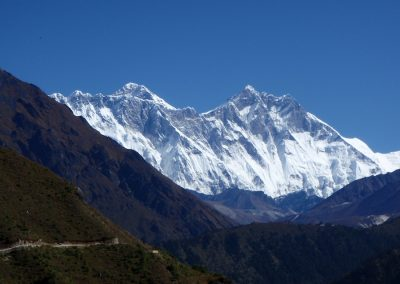 The way forward Everest dominating the skyline with Tengboche monastery just visible in the foreground on the right hand sideds