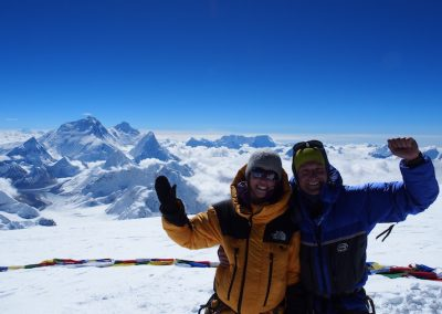 Rob and MK on the summit of Cho Oyu - 6th highest mountain in the world.  Everest in the background.