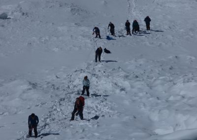 Looking down the headwall at team mates on their way up