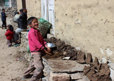 're going to make yak dung patties (to use as fuel) - you may as well have fun doing it! Street scene Khumjung