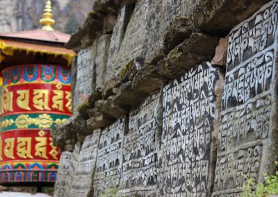 Mani stones and prayer wheel