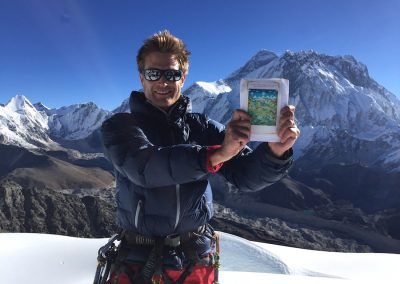 The climb  - On the summit with a prayer card from Lama Geshe